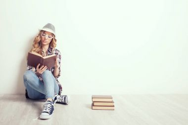 Girl on the floor with books
