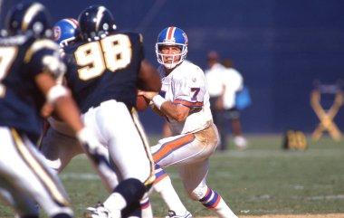 Denver Broncos quarterback John Elway in NFL action during the 1980's.