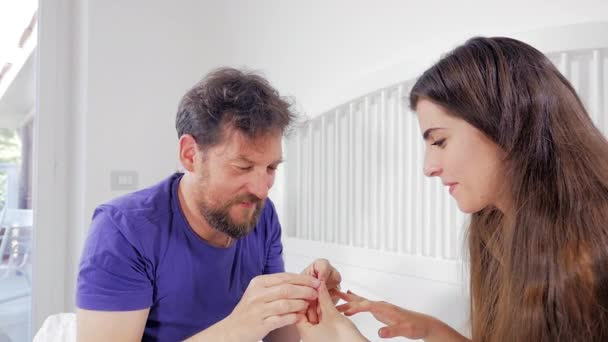 Man putting engagement ring to girlfriend