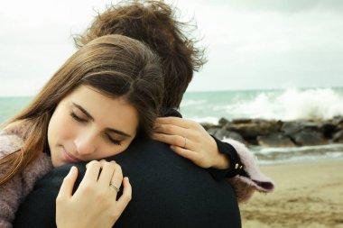 Happy woman hugging tight boyfrien stock vector