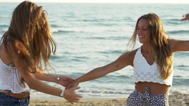 Happy teenagers dancing during party on the beach at sunset 160fps slow motion medium shot