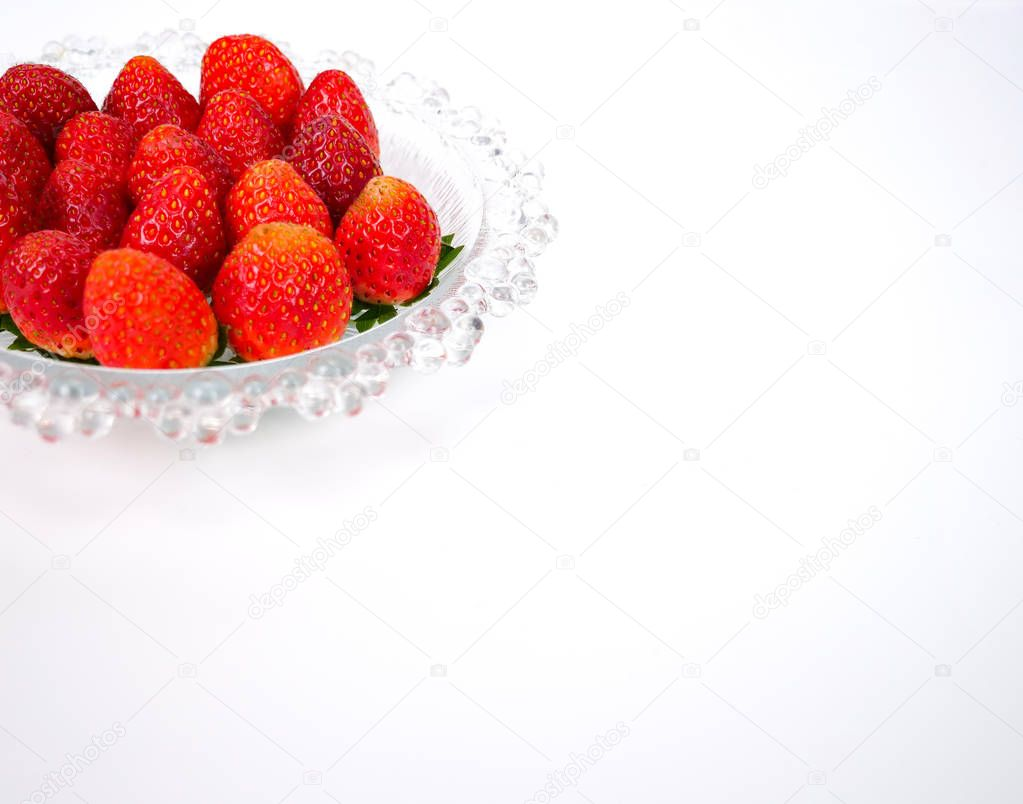fresh strawberries on a glass plate
