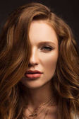 portrait of beautiful brown-haired girl looking at camera