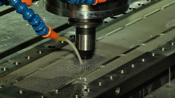 Drilling a metal workpiece on a drill press