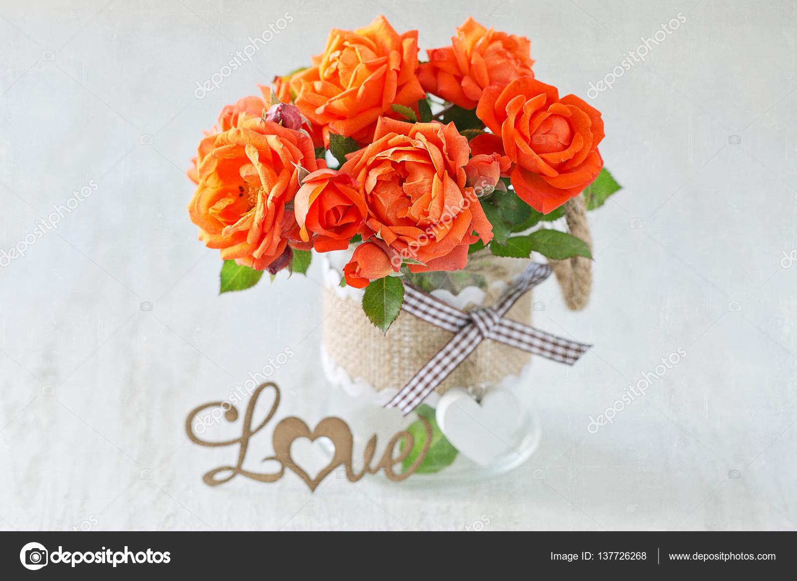 Beautiful fresh roses flowers stock photo ulchik74 137726268 lovely bunch of flowers autiful fresh roses flowers in a vase decorated with a heart on a background with texture photo by ulchik74 izmirmasajfo