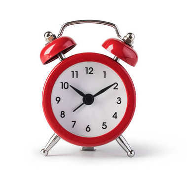 Red old style alarm clock isolated on white stock vector