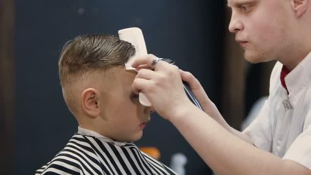 Hairdresser Making Hair Cut For Little Boy Machine Barber Cutting