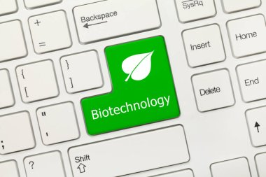 Close-up view on white conceptual keyboard - Biotechnology (green key)