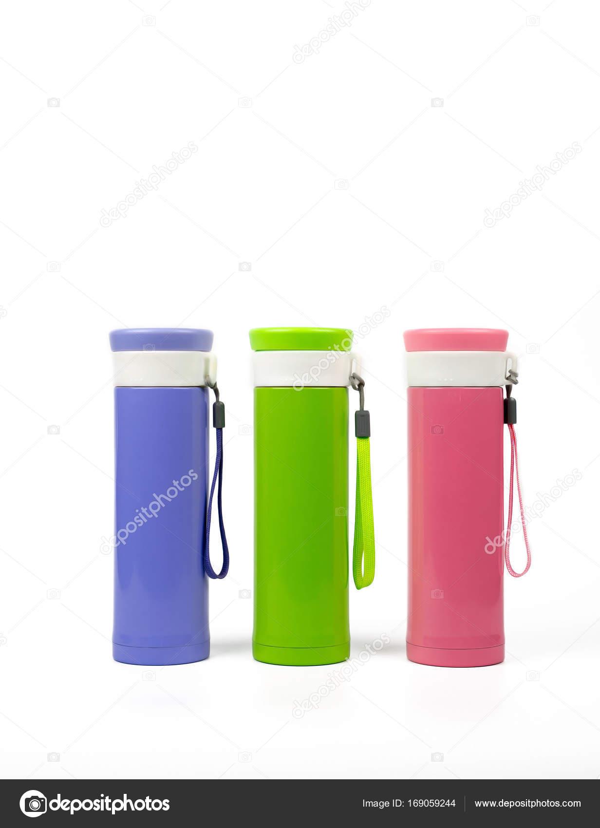 Púrpura, verdes y rosa botellas termo aisladas sobre fondo blanco ...