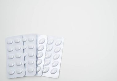 Statins tablets pill in white blister pack for light resistance packaging isolated on white background. Medicine for treatment dyslipidemia. Lipid lowering tablets pills. Statins : Hyperlipidemia.
