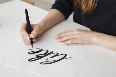 Close up photo of young woman hands writing on paper on desk  isolated stock vector
