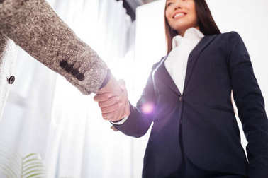 Portrait of business handshake in office isolated