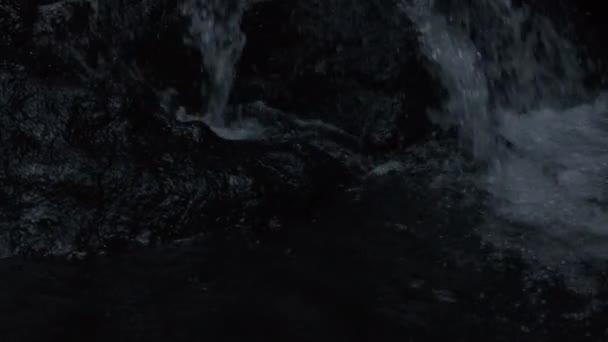 Close up shot of amazing tropical waterfall at night