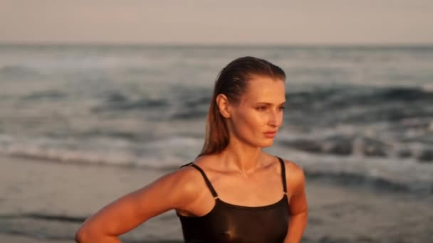 Tracking shot of gorgeous girl confidently walking by the ocean on paradise island
