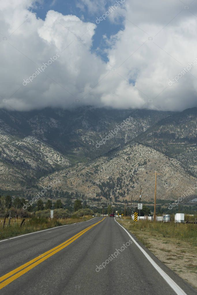 Empty road with majestic mountains