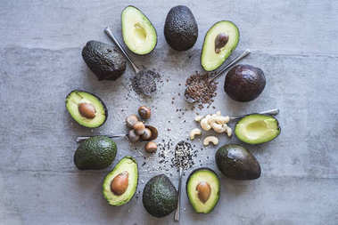 avocado halves with spices and nuts