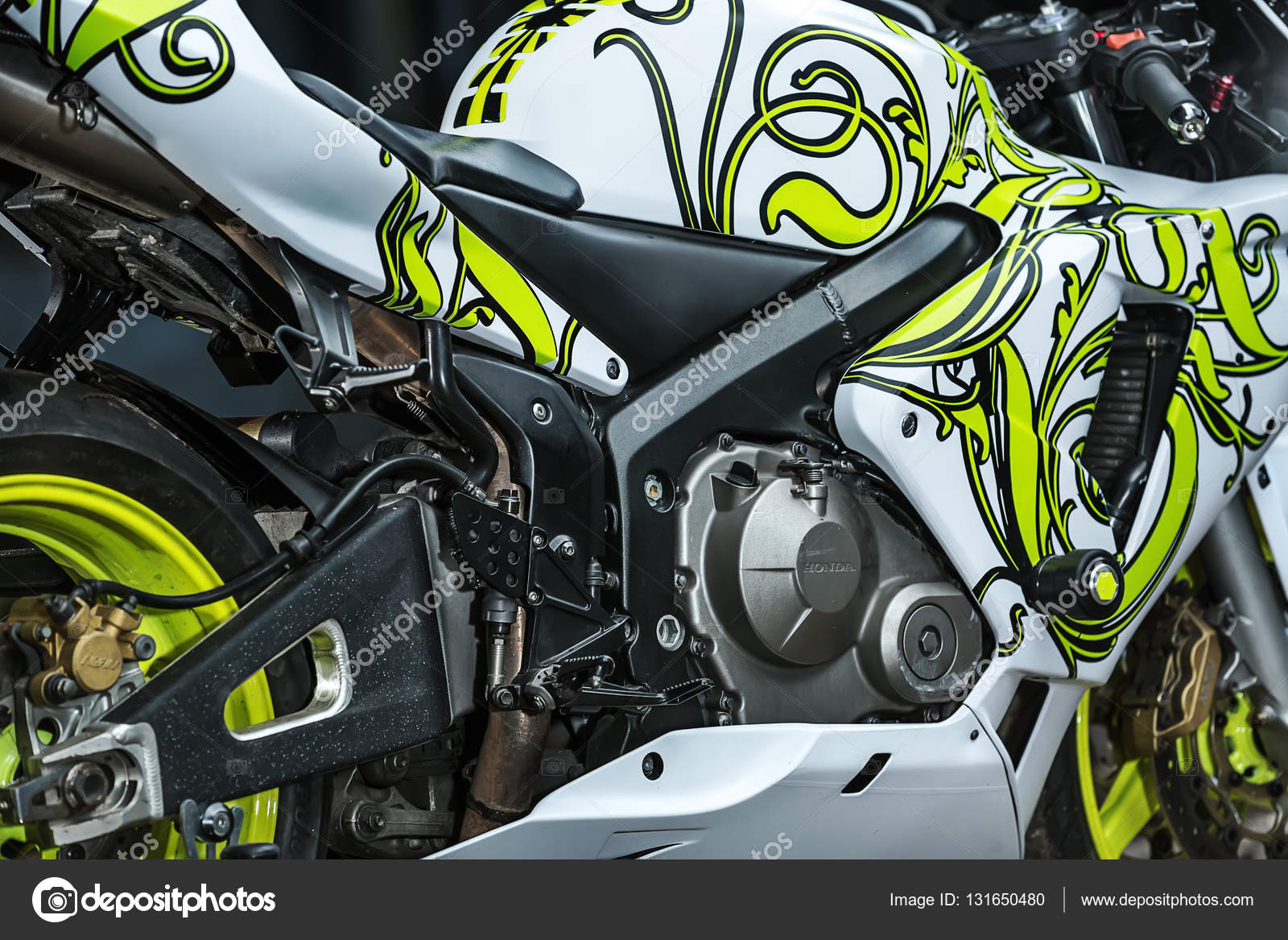 kiev ukraine 14 may 2014 honda tuning sport motorcycle it colored in white color with lime prints editorial photo closeup side view - Moto Tuning
