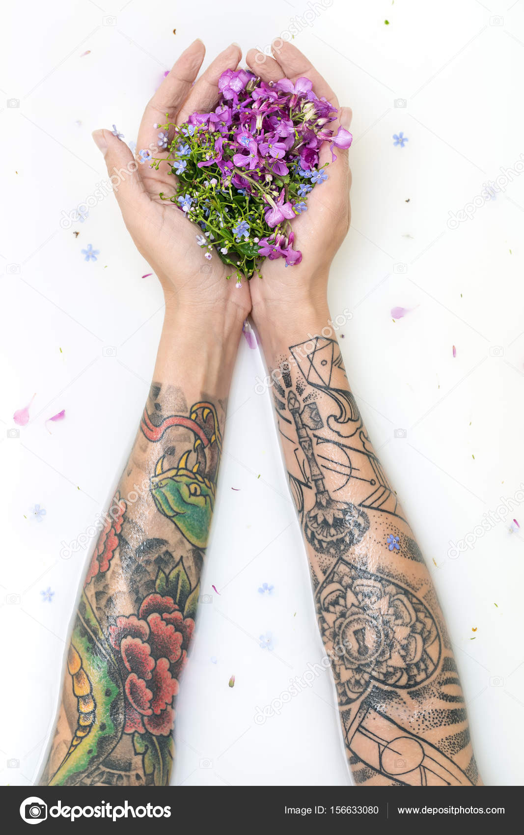 depositphotos_156633080-stock-photo-girls-hands-with-tattoos-and.jpg
