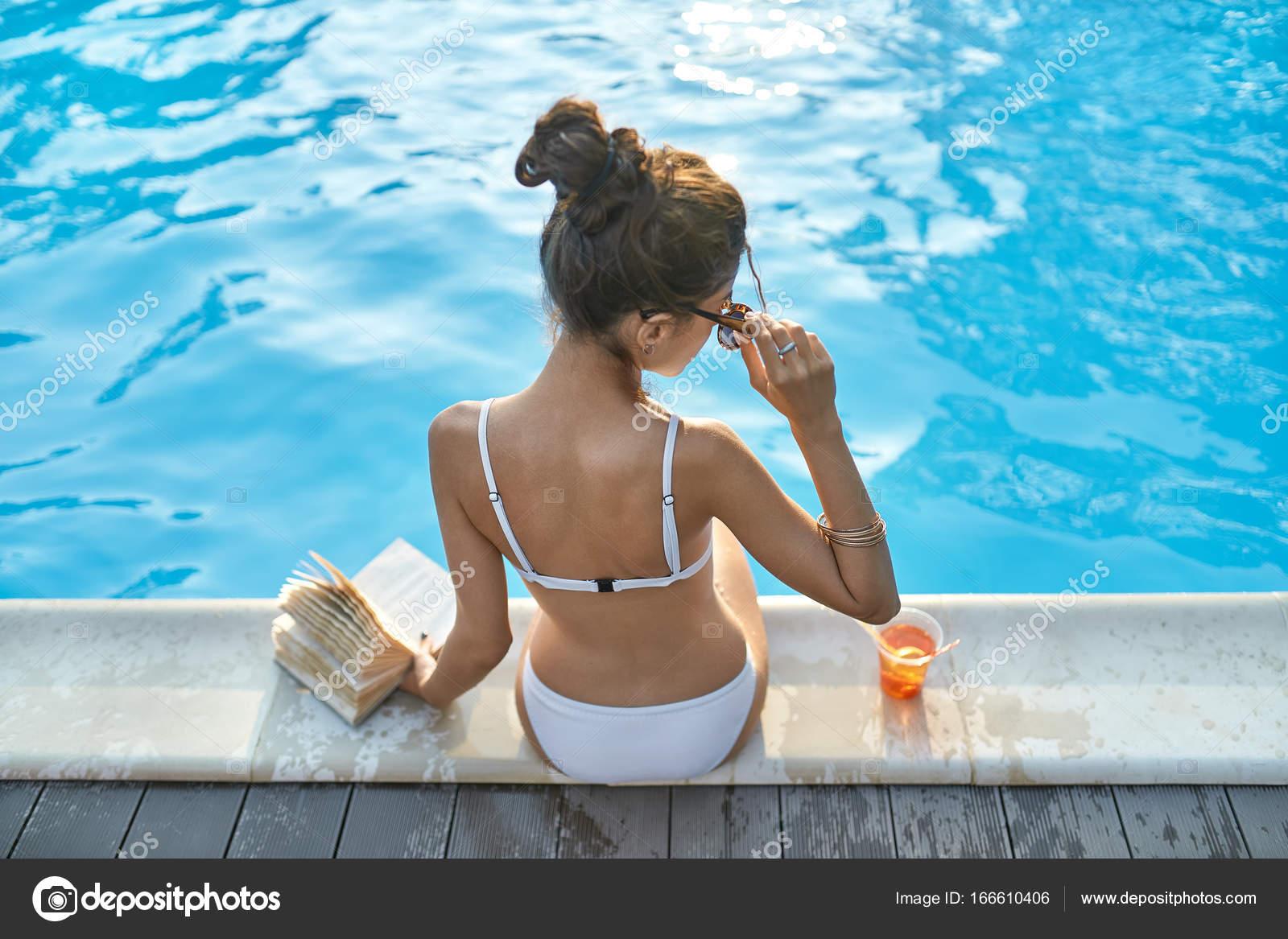 Model near swimming pool outdoors — Stock Photo © bezikus ...