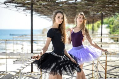 Ballet dancers posing outdoors