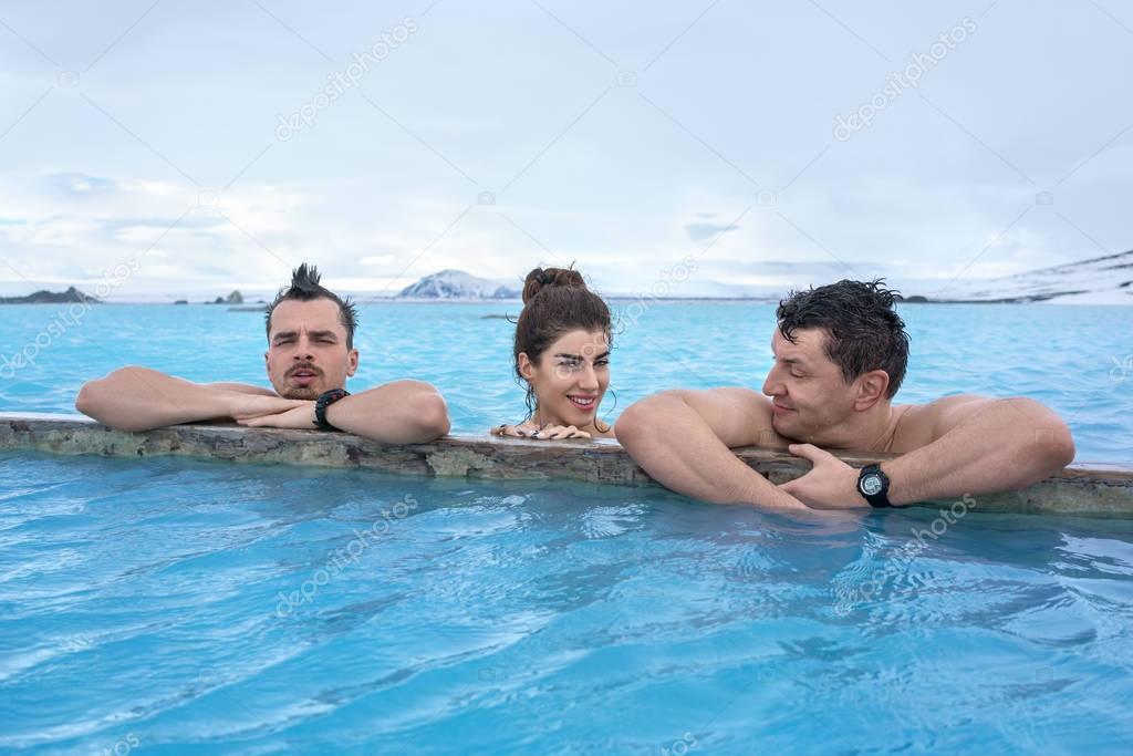 People relaxing in geothermal pool outdoors