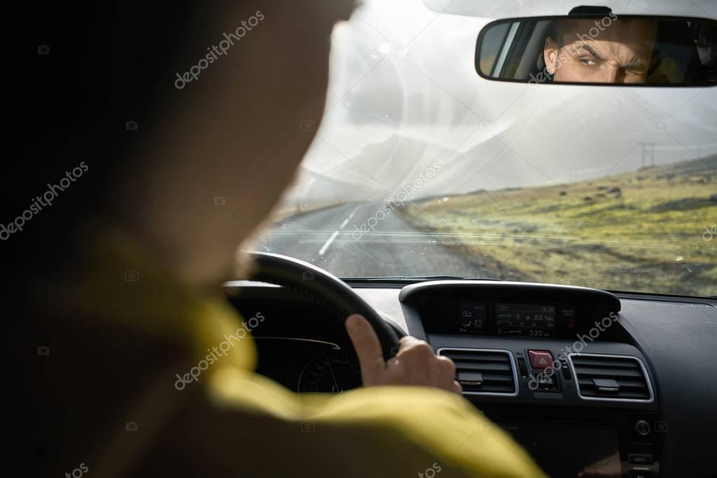 View at Icelandic landscape from inside car