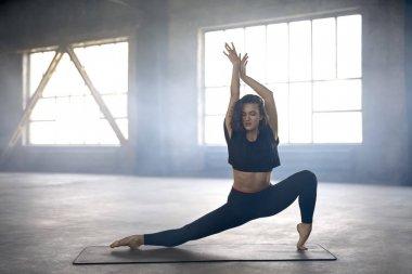 Sportive girl yoga training