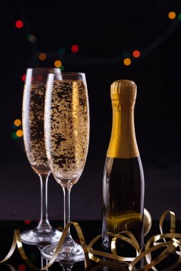 Two Glasses of Champagne against Blurred Christmas Lights. Shallow Depth of Field.