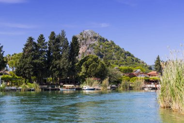 Dalyan River with tourist boats in the straits of the river