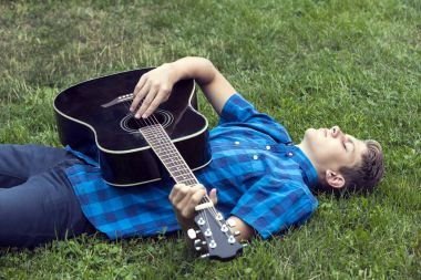 Young sad guy with guitar