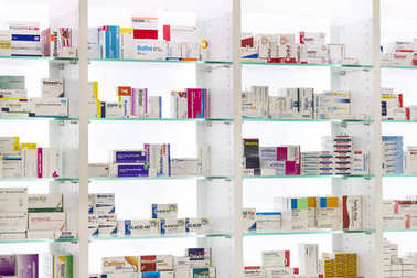 Pharmacy cabinets with medicines and drugs tablets and food additives