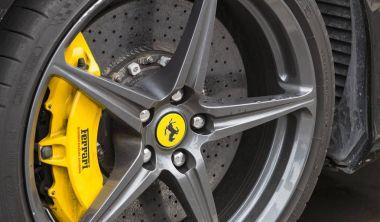 Emblem of a Ferrari car shot close-up on the streets of the city