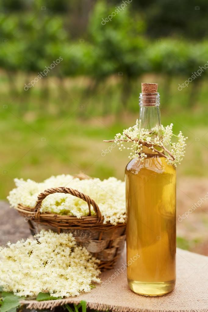Homemade elderflower syrup in a bottle