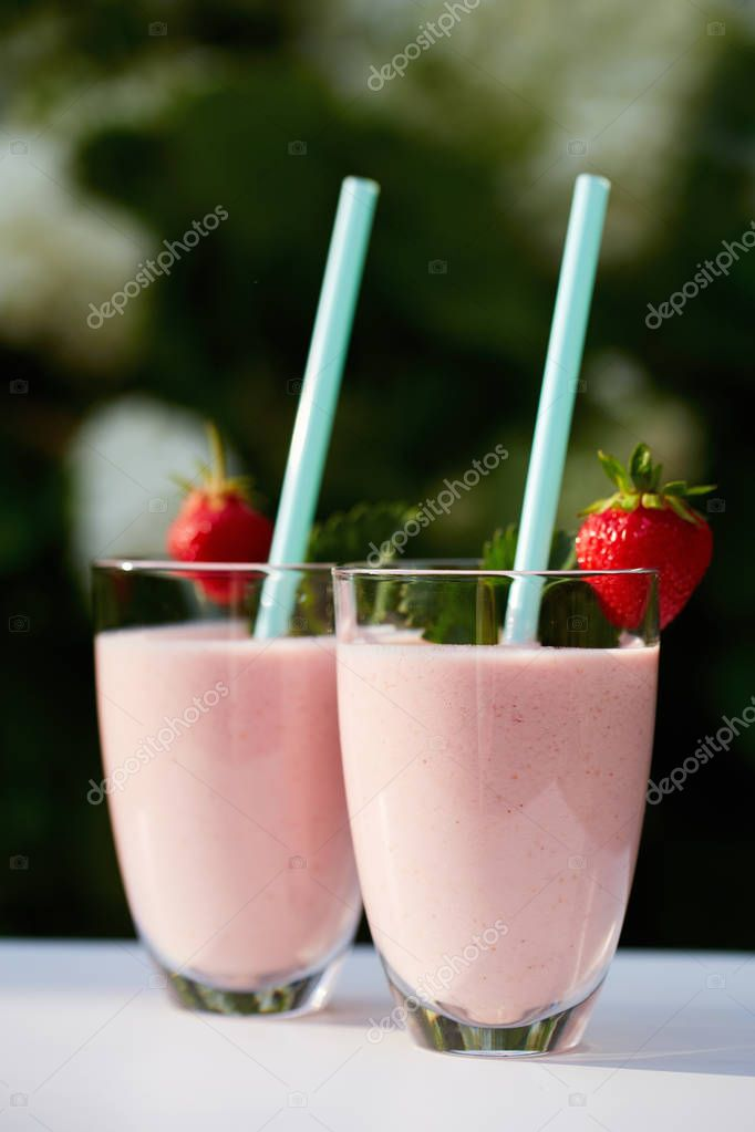 Glasses of fresh smoothie with strawberry