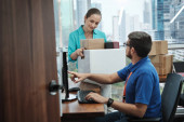 IT Expert Setting Computer To Woman Moving Into New Office