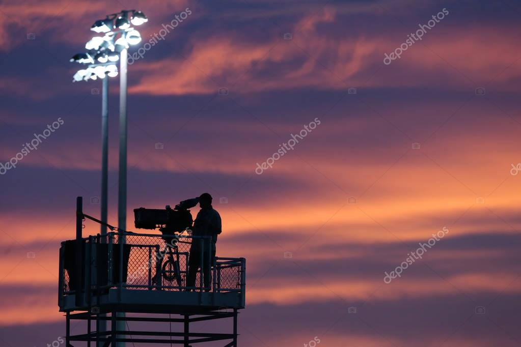 TV Cameraman At Sunset