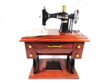 Sewing machine. Souvenir toy. Photo of a toy sewing machine.