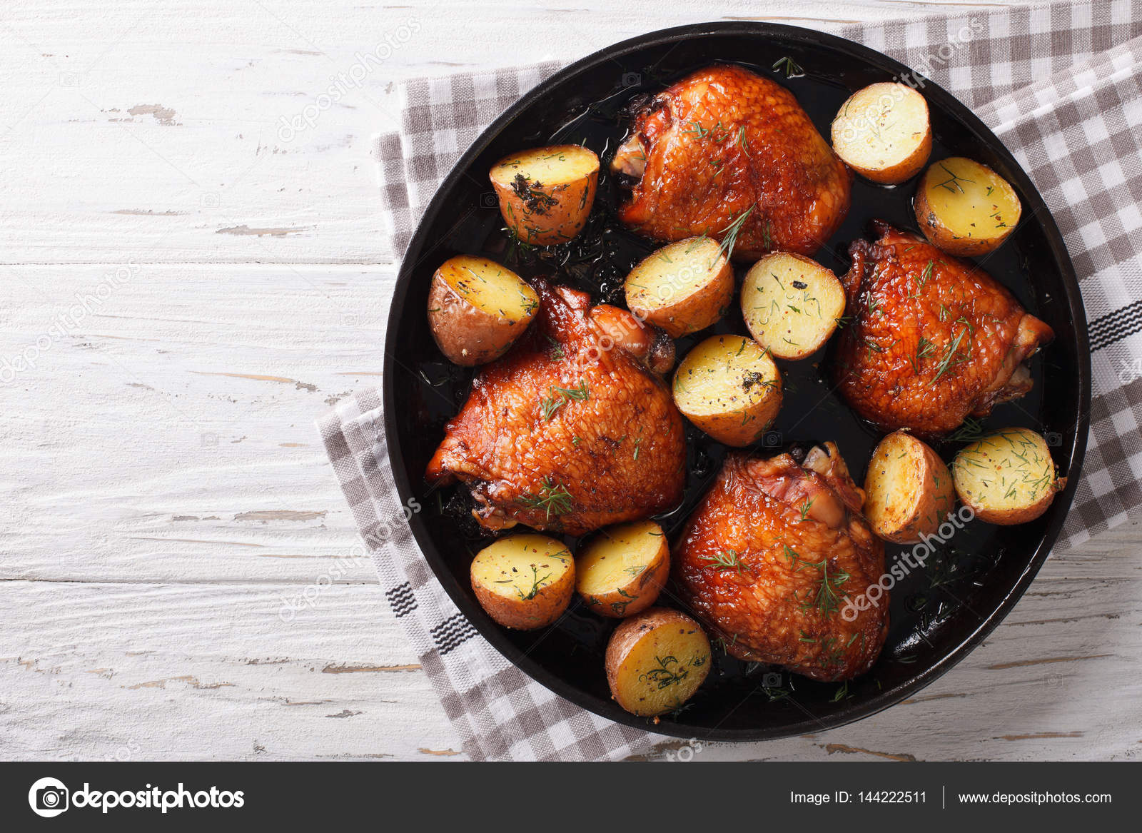 Roast chicken thighs and baby potatoes with maple syrup closeup roast chicken thighs and baby potatoes with maple syrup closeup stock photo forumfinder Image collections