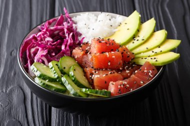Organic food: tuna poke bowl with rice, fresh cucumbers, red cab