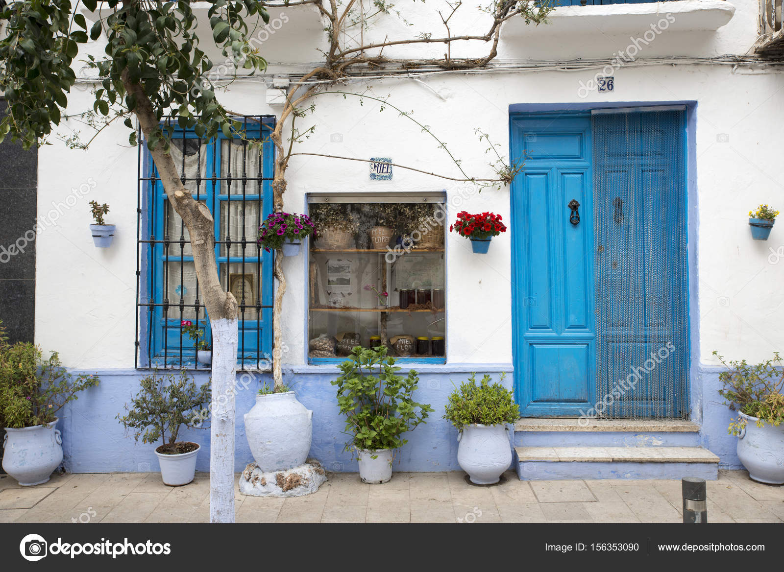 Typical blue and white house in spain stock photo for Blue and white house