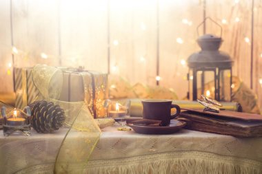 Christmas decoration. Old book with eyeglasses, cup of coffee