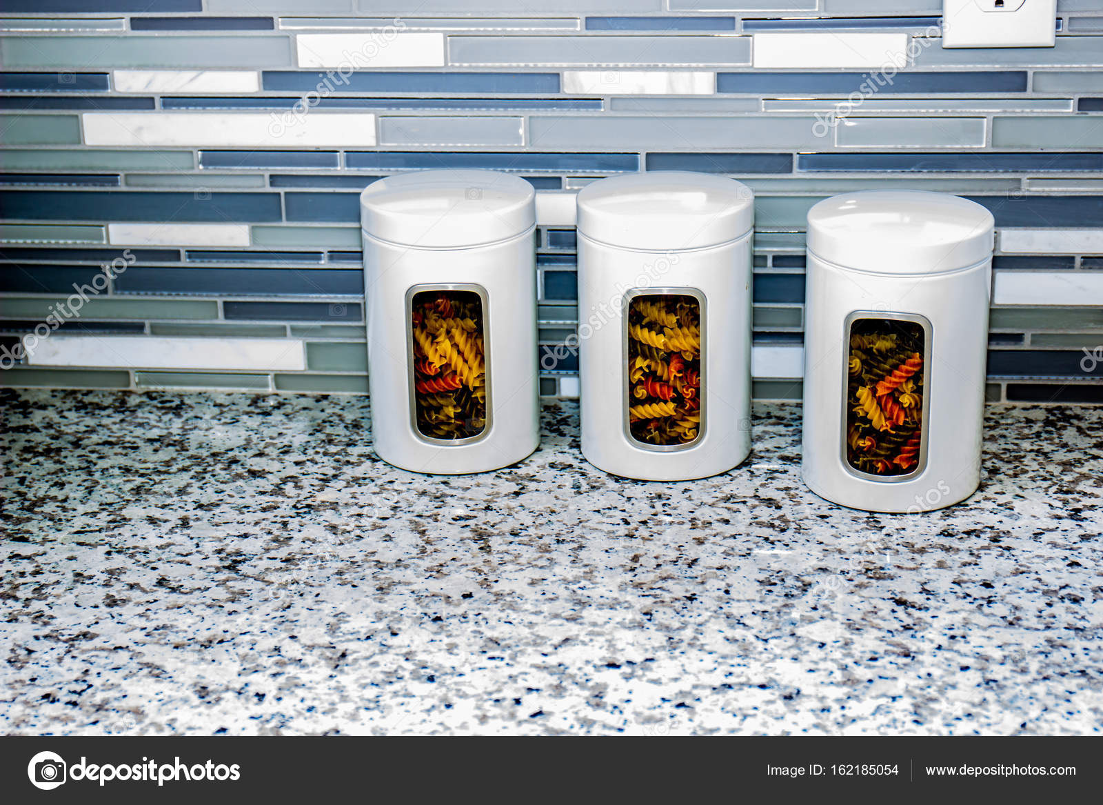 Three White Pasta Canisters On Kitchen Counter — Stock Photo ...