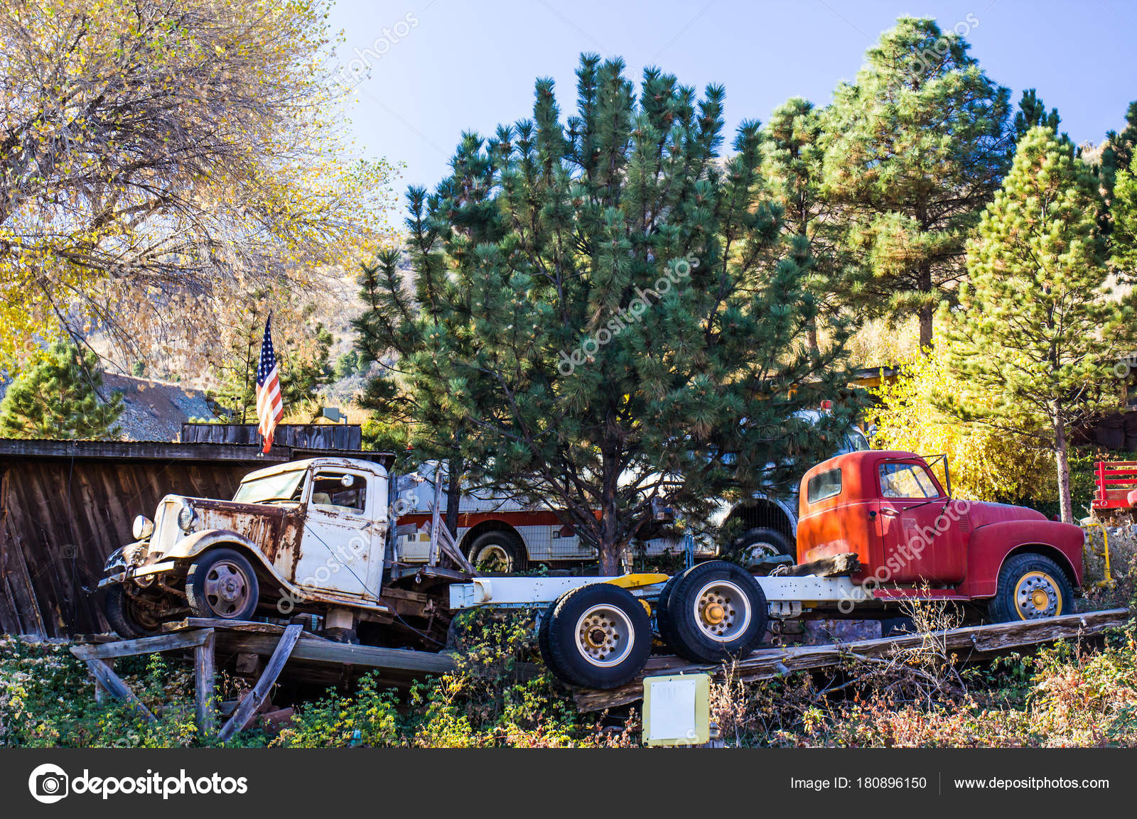 Two Vintage Trucks In Salvage Yard — Stock Photo © weezybob5 #180896150