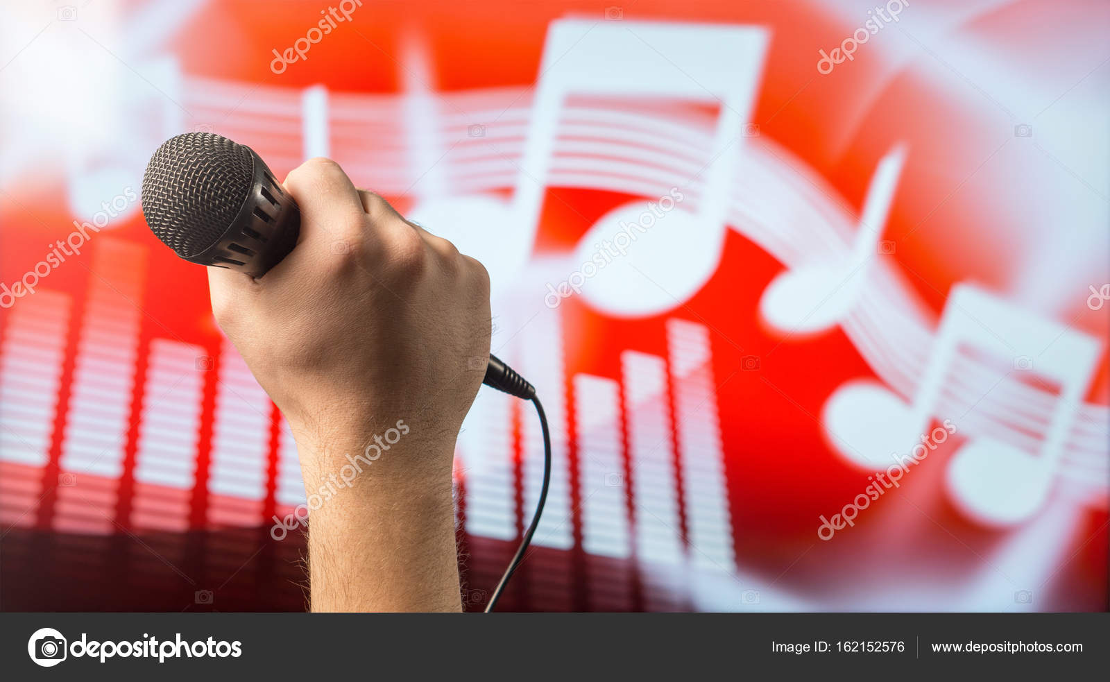 Man holding microphone in front of an abstract music and