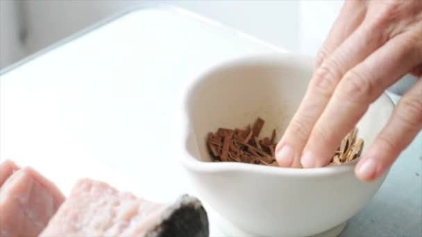 Close-up of person using mortar and pestle