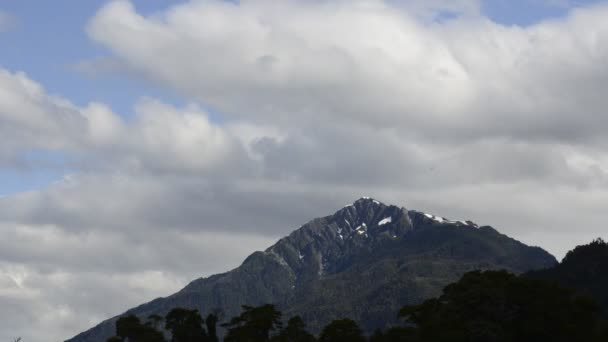 Clouds moving over majestic mountain