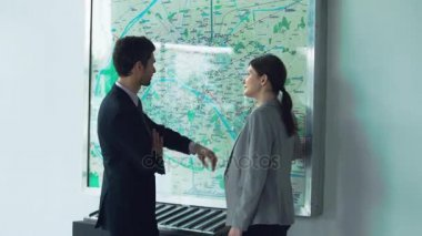 Business people arguing while looking at subway map
