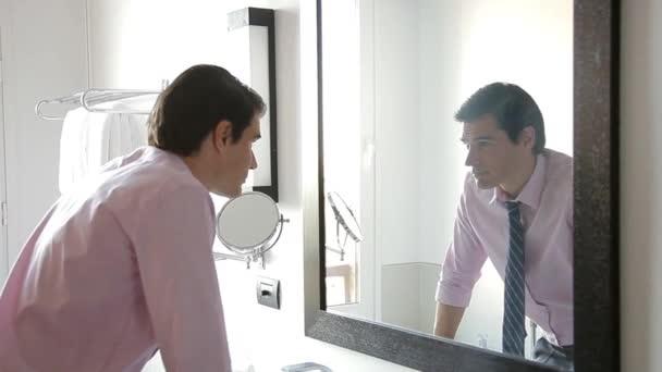 Man looking at self in mirror