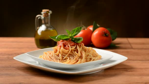 steaming plate of spaghetti with tomato sauce