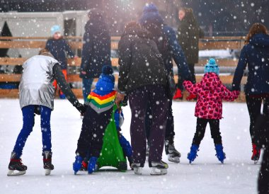 Ice skating rink with lot of people